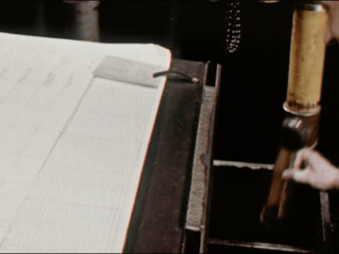 1964 close up newspaper editor at new york newsday receives marked-up copy from tube / long island, new york / audio - ニューヨークニュースデイ点の映像素材/bロール