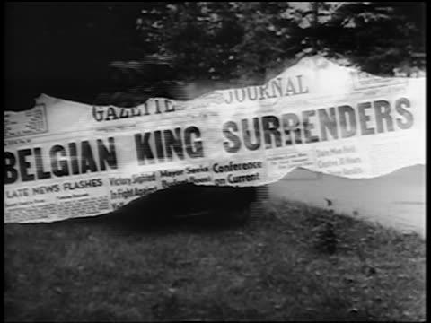 close up newspaper headline: belgian king surrenders / german soldiers in off-road vehicles - newspaper headline stock videos & royalty-free footage