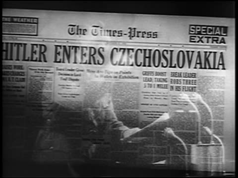 vídeos de stock, filmes e b-roll de hitler enters czechoslovakia / hitler giving speech - primeira página de jornal