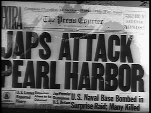 vídeos y material grabado en eventos de stock de close up newspaper headline: japs attach pearl harbor / map - 1941