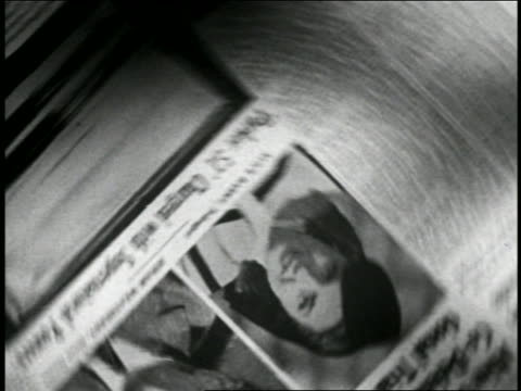 B/W 1946 close up newspaper spinning with photos of man + woman 'co-defendants' in trial / industrial