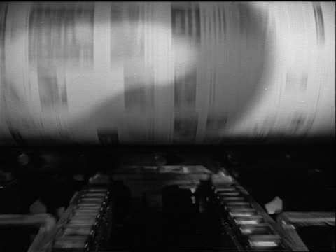 B/W 1948 close up newspapers being printed on printing press / Millions of Masterpieces