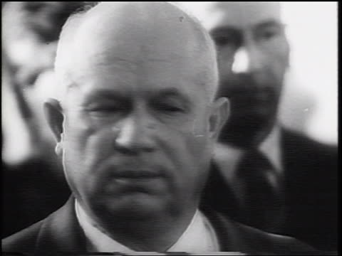 B/W 1960 close up Nikita Khrushchev looking around / others in background / USSR / newsreel