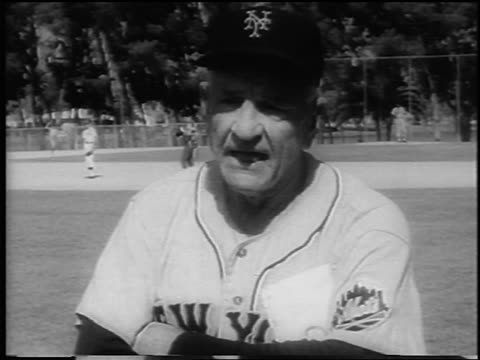 vídeos de stock, filmes e b-roll de b/w 1962 close up ny mets manager casey stengel with folded arms talking during spring training / newsreel - 1962