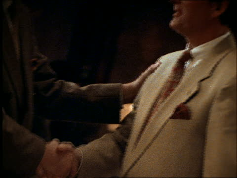 close up of 2 businessmen shaking hands - suit stock videos and b-roll footage