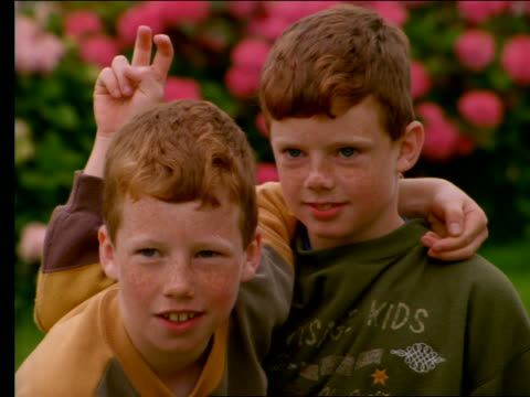 close up of 2 irish boys making faces + goofing off - teasing stock videos & royalty-free footage