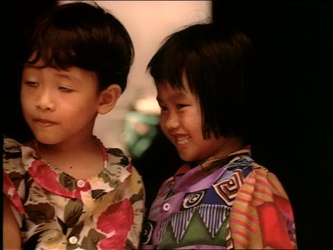 vídeos de stock, filmes e b-roll de close up of 2 small vietnamese girls - ocidentalização