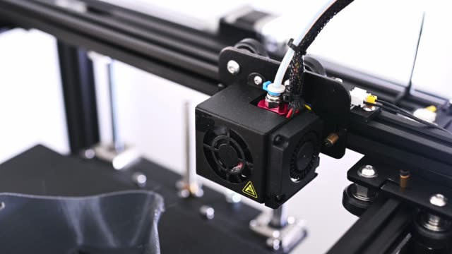 close up of a 3d printer printing head - compact fluorescent light bulb stock videos & royalty-free footage