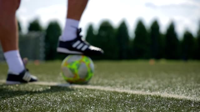 close up of a ball and foot in little blur - slow motion stock video - turf stock videos & royalty-free footage