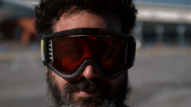 close up of a bearded man with orange ski goggles, - ski goggles stock videos & royalty-free footage