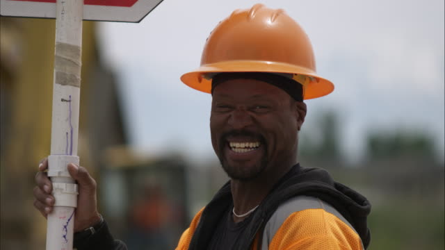 Close up of a black road construction worker.