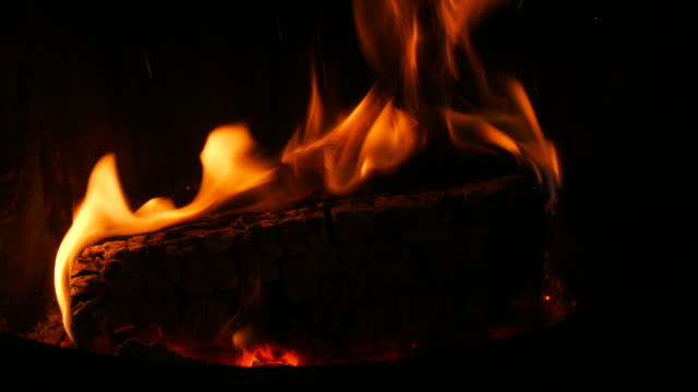 close up of a blazing wood log on an open fireplace - log stock videos & royalty-free footage