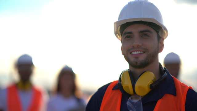 close up of a blue collar worker looking away daydreaming very happy - work helmet stock videos & royalty-free footage