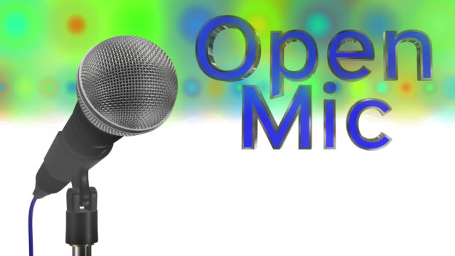 Close up of a cardioid dynamic ball head microphone turning on a stand the words open mic are displayed in chrome 3D letters with a blue inlay there are also rows of colours representing lights and haze all on a blue background saved with alpha channel