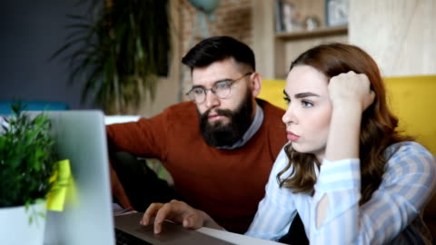 close up of a couple working from home - husband stock videos & royalty-free footage