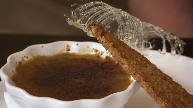 close up of a creme brule, spun sugar and biscuit - sugar bowl crockery stock videos and b-roll footage
