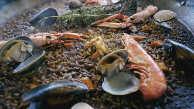 Close up of a delicious and hot paella.