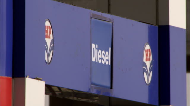 close up of a diesel sign on a petrol station forecourt. - fuel pump stock videos and b-roll footage