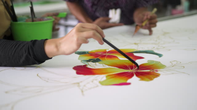 close up of a flower being coloured on batik - batik stock videos and b-roll footage