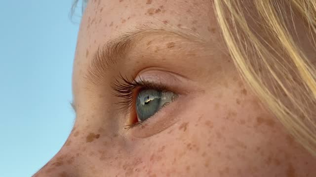 close up of a girls eye blinking - blinking stock videos & royalty-free footage