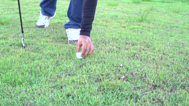 close up of a golf ball being played - golf glove stock videos and b-roll footage