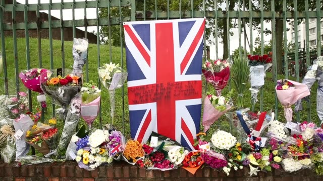 close up of a great british flag left at the scene where drummer lee rigby of the 2nd battalion the royal regiment of fusiliers was killed on may 24... - brutal killing stock videos & royalty-free footage