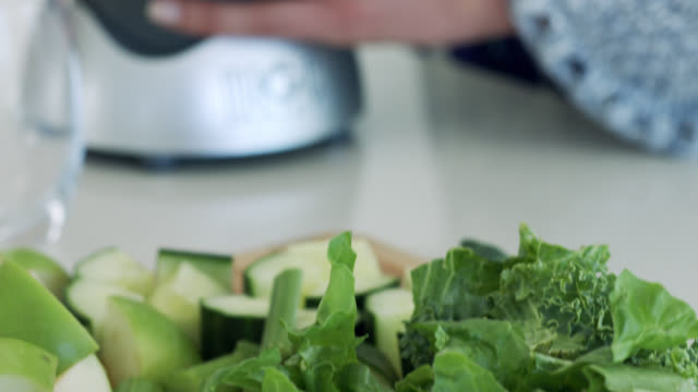 close up of a green vegetable juice being made in a blender - urbanlip stock videos & royalty-free footage