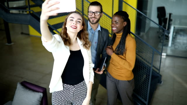 close up of a group of coworkers taking selfie - millennial generation stock videos & royalty-free footage