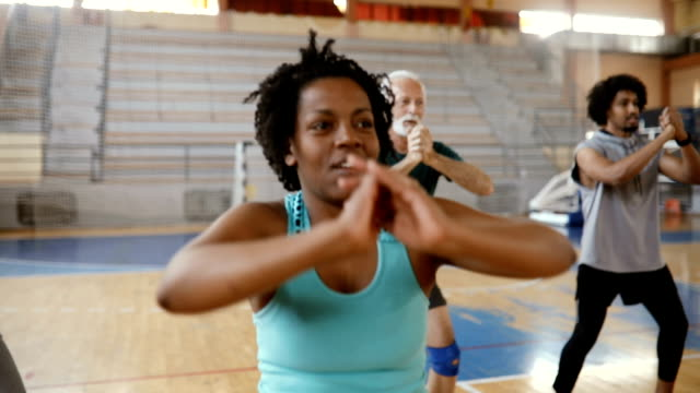 close up of a group of people doing exercise at aerobic class - aerobics stock videos & royalty-free footage