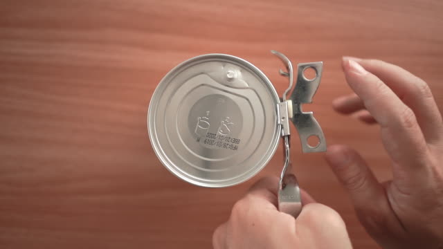 close up of a hand opening can - can opener stock videos and b-roll footage