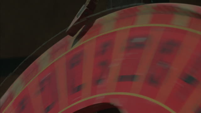 Close up of a hand spinning a number-wheel.
