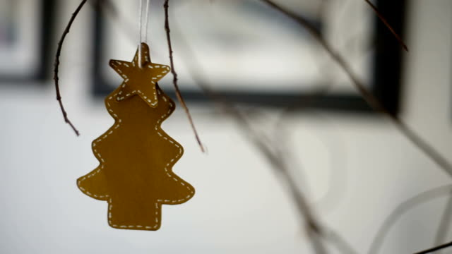 close up of a handmade cardboard pine tree ornament with a star on the top hanging from a branch. - hanging up stock videos and b-roll footage