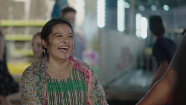 close up of a hispanic woman laughing with her family at a summer carnival - latin american and hispanic ethnicity stock videos & royalty-free footage