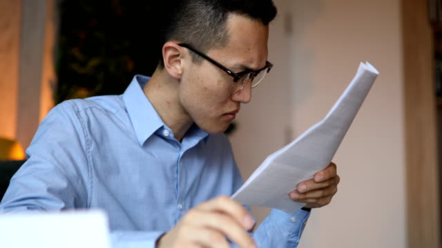 close up of a man calculating his financial bills - bank statement stock videos & royalty-free footage