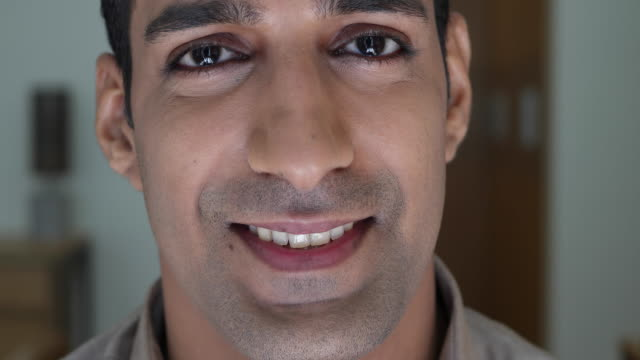 close up of a man's face, smiling straight at camera - hair stubble stock videos and b-roll footage