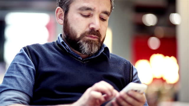 close up of a man's hand holing and using a mobile phone - holing stock videos & royalty-free footage