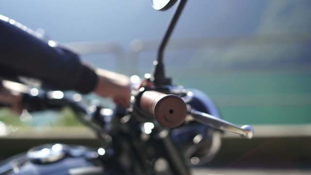 close up of a man's hand throttling a motorcycle - throttle stock videos & royalty-free footage