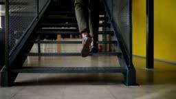 Close up of a man's leg climbing stairs