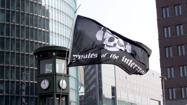 close up of a pirates of the internet protest flag flying in the wind at a protest rally - protestor stock videos & royalty-free footage