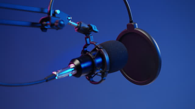 stockvideo's en b-roll-footage met a close -up of a professional microphone against the blu background in a studio light - media interview