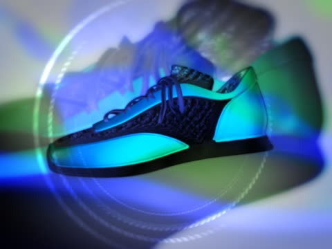 close up of a revolving training shoe - scarpe da ginnastica video stock e b–roll