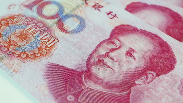 close up of a rotating 100 chinese yuan banknote, 4k resolution. - china east asia stock videos & royalty-free footage