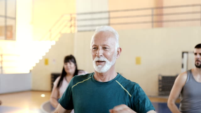 close up of a senior man dancing in a group class - dance studio stock videos & royalty-free footage