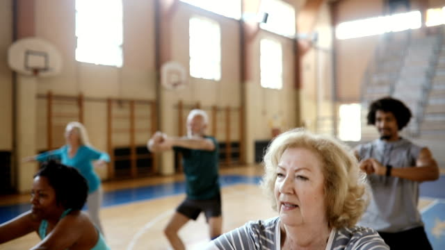 close up of a senior woman doing exercise at aerobic class - dance studio stock videos & royalty-free footage