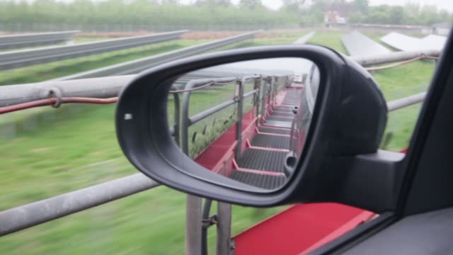 close up of a side mirror reflection shot from a moving train car transport train on may 18 2013 in westerland federal republic of germany - insel sylt stock-videos und b-roll-filmmaterial