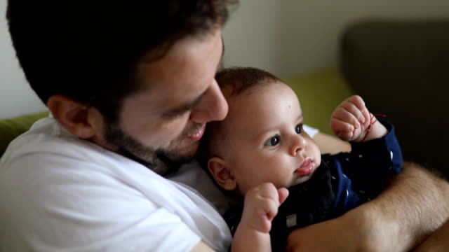 close up of a smiling dad and baby - modern manhood stock videos & royalty-free footage
