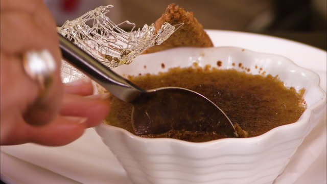 Close up of a spoon picking up some creme brule