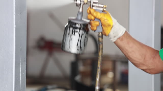 close up of a spray paint gun - spray painting stock videos & royalty-free footage
