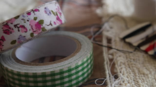 a close up of a tailor's desk - sticky tape stock videos & royalty-free footage