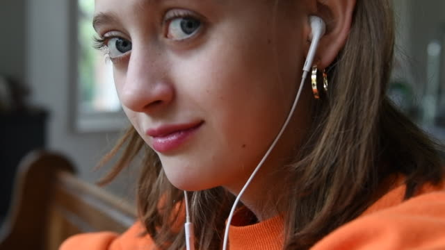 close up of a teenage girl wearing headphones and laughing - eccentric stock videos & royalty-free footage